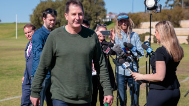 Ross Lyon departs his media conference after being sacked by Fremantle.
