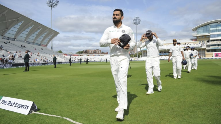 Dominant performance: Indian captain Virat Kohli leads his team off the field after beating England in the third Test.