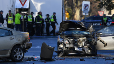 Police investigate a car accident at the scene of the brawl.