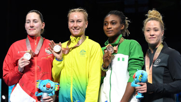 Paige Murray of England, Anja Stridsman of Australia, Yetunde Odunuga of Nigeria and Troy Garton of New Zealand during the medal ceremony.