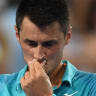 Tomic falls to Cilic despite late fightback