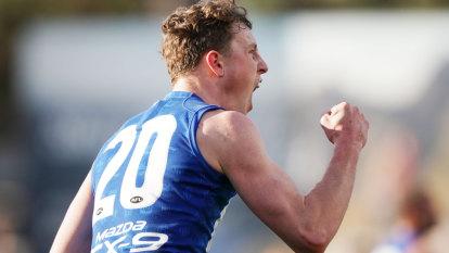 Kangaroos score late winner to stun Demons
