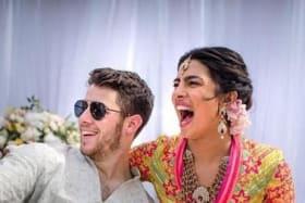 Priyanka Chopra and Nick Jonas celebrate during their mehendi ceremony, a day before their wedding.