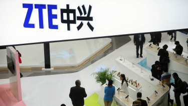 People gather at the ZTE booth at the Mobile World Congress in Barcelona, Spain.