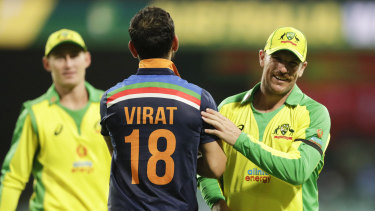 Kohli congratulates Finch after Australia's victory.