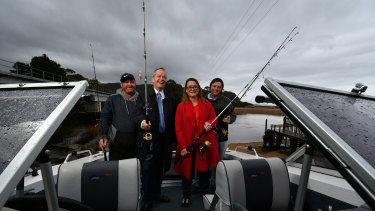 Ulverstone fishermen Troy Brooks (left) and Matt Talbot (right) at Heybridge boat ramp with Bill Shorten and Justine Keay as part of the publicity for Labor's $10m recreational fishing fund.