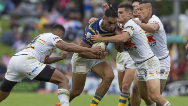 Backs to the wall: Cleary and Penrith try to contain Parramatta's Marata Niukore.