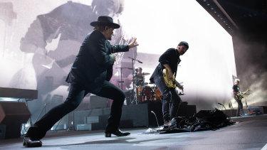 U2 frontman Bono, lifting the spirits at Perth's Optus Stadium with guitarist The Edge, bassist Adam Clayton and drummer Larry Mullen.