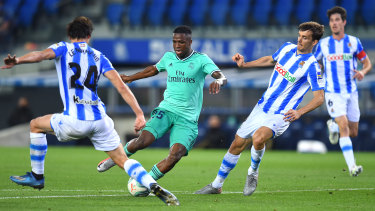 Real Madrid's Vinicius jnr controls the ball against Real Sociedad in La Liga.