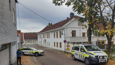 Police cordon off one of the sites where a man killed several people in Kongsberg, Norway.