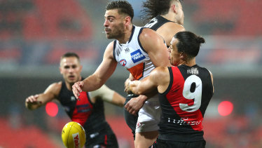 Stephen Coniglio of the Giants is tackled by Dylan Shiel of the Bombers.