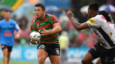 Playing distributor: Sam Burgess on the ball for the Rabbitohs against the Panthers.