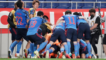 Japan celebrate their win over Australia in the world cup qualifier in Tokyo