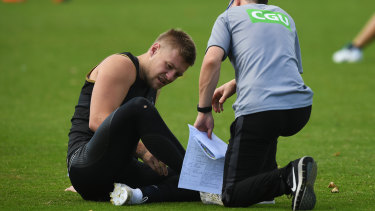 Collingwood's Jordan De Goey gets attention at training on Tuesday.
