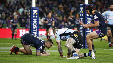 Melbourne Storm's Cameron Munster scores a try against the Sharks in round 17.