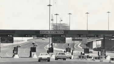 Entrance to the bridge at 5.00 pm - evening peak hour traffic, 1979. Tolls were abolished in 1985, because drivers were using other routes to avoid the toll.