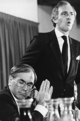 Andrew Peacock launches his economic policy at the National Press Club in 1984 while John Howard listens.