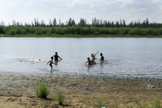 Children play in the Krugloe Lake outside the Arctic town of Verkhoyansk, about 4660 kilometres north of Moscow where the temperature hit 38 degrees this week.
