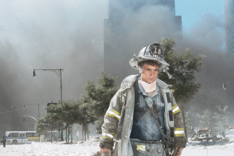 A firefighter walking away from Ground Zero after the collapse of the Twin Towers.