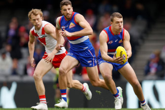 Jack Macrae gets a possession against the Swans.