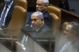 Outgoing Israeli Prime Minister Benjamin Netanyahu looks on after parliament voted to approve the new government and end his 12-year leadership.