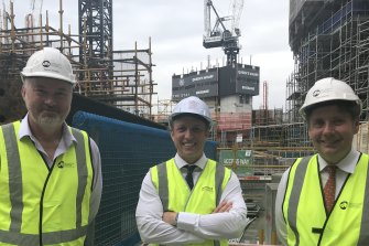 Planning Minister Steven Miles (centre) facing community pressure for review of protections for Brisbane's character housing. Here with  Destination Brisbane project director Simon Crooks and Star CEO Matt Bekier