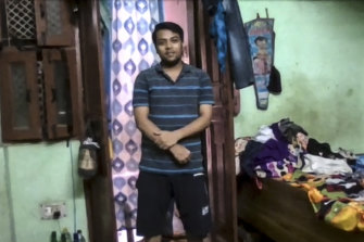 Tushar Joshi inside his family home in a Delhi slum. He is studying a master of international relations remotely at the University of Sydney.