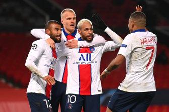Neymar celebrates with teammates after scoring PSG's third goal.