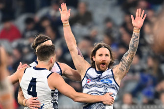 Zach Tuohy celebrates after scoring for the Cats in their win over Carlton.