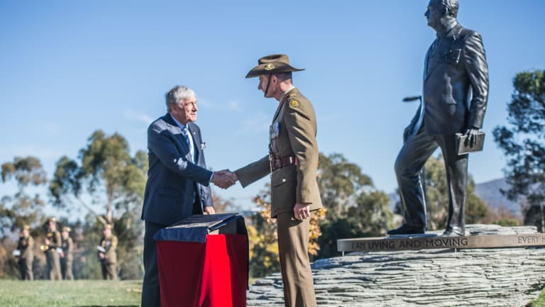 Australian War Memorial Council chair Kerry Stokes and Chief of Army Lieutenant General Rick Burr unveil the plaque beside a commemorative sculpture of General Sir John Monash.