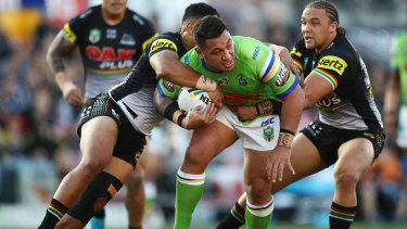 Josh Papalii is wrapped up by the Panthers' defence.