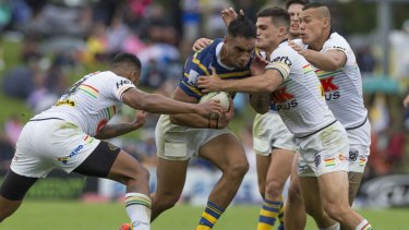 Backs to the wall: Penrith try to contain Parramatta's Marata Niukore.