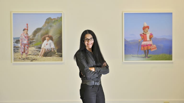 Polixeni Papapetrou pictured with her works at a 2012 show at Melbourne's Nellie Castan Gallery.
