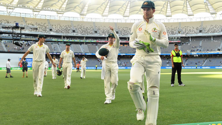 Tim Paine leads the Australians off the field on day four.