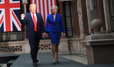 US President Donald Trump and British Prime Minister Theresa May arrive for a press conference in London on Tuesday.