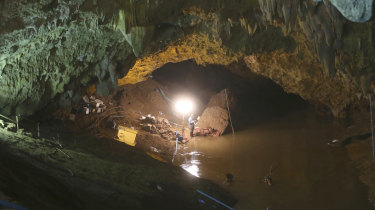 Thai rescuers work at the entrance to the cave.