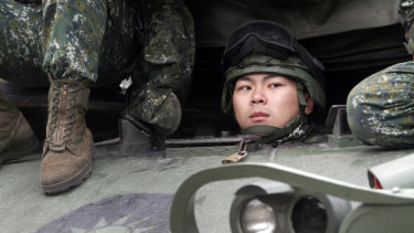 A Taiwanese soldier watches from a tank during military exercises in Taichung on Thursday.