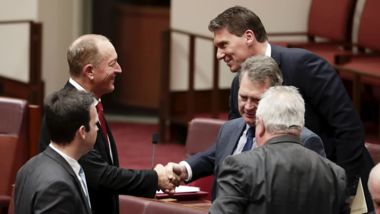 Fraser Anning is congratulated by Cory Bernardi after delivering his first speech in the Senate.