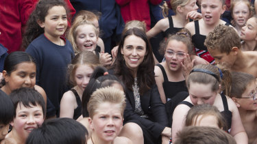 New Zealand PM Jacinda Ardern sits with the children of Spreydon West school on Friday.