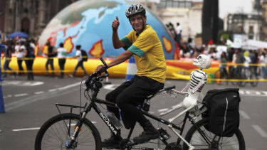 A man rides protests climate change in Mexico City on Friday, as thousands of people took the streets around the globe  in the run-up to a UN summit to demand leaders tackle the problem.