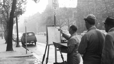 Mr. Dermot Hellier, at work near the corner of Collins Street and Russell Street, Melbourne, 1965.