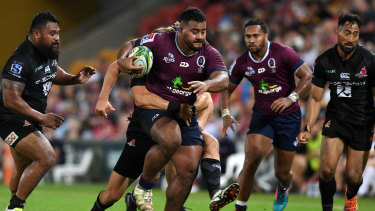 Taniela Tupou (centre) in action for the Reds.