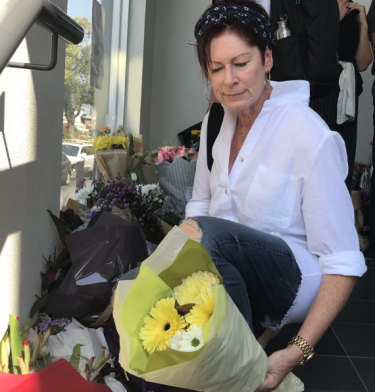 Kerry Gavin lays flowers at the Albanian mosque in Carlton.