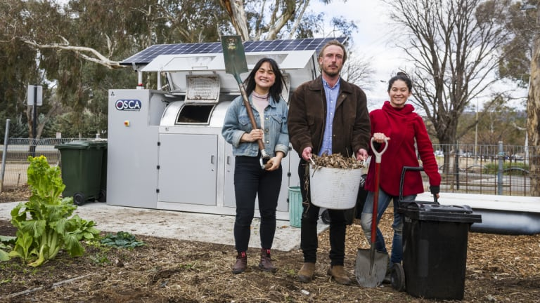 Events and projects manager Gaby Ho, director Ryan Lungu, garden coordinator Karina Bontes Forward next to their new public composter at the Canberra Environment Centre.