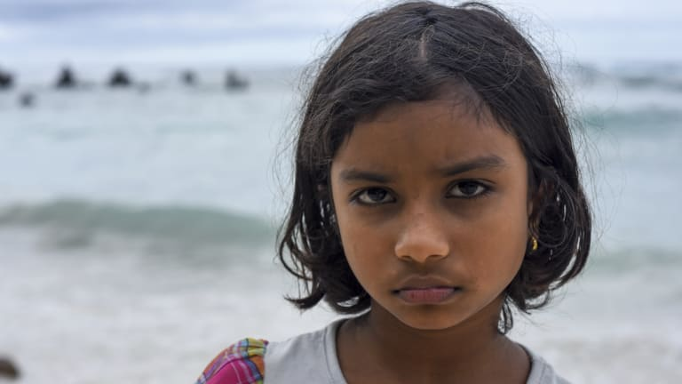 Sri Lankan refugee Sakinthana, 8, at the beach on Nauru.