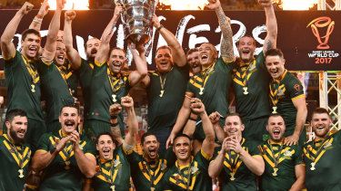 Top of the perch: Australia celebrate winning the Rugby League World Cup final.