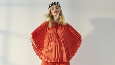 Stella McCartney top, $1480, and pants, $1055. Maison Michel turban, $1050.