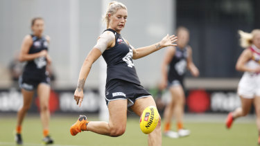 On target: Carlton's Tayla Harris puts the boot into an attempt on goal during the round 6 clash against Brisbane at Ikon Park in Melbourne.