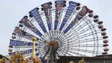 A Beirut Ferris wheel is used in the election campaign of Lebanese Prime Minister Saad Hariri , left.