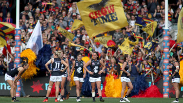 Feeling blue: Carlton players after the loss to Adelaide.